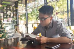 Reading book is good habit for young people. Man reading book is good habit for young people royalty free stock photography