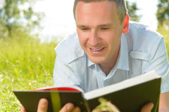 Man reading book Stock Photos