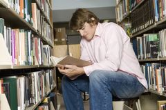 Man Reading Book In The Library Stock Photography