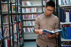 Man reading book in library Stock Image