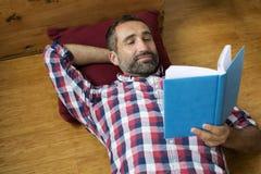 Man reading book Stock Image