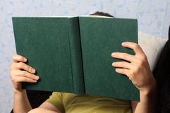 Man  reading book lying Stock Image