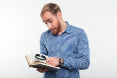 Man reading book with magnifying glass Royalty Free Stock Image