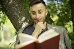 Man reading book about modern psychology Royalty Free Stock Images