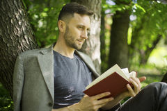 Man reading book about modern psychology Royalty Free Stock Photography