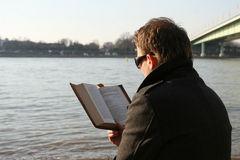 Man reading book outdoor Stock Images
