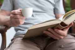 Man reading a book outdoor Royalty Free Stock Image