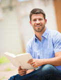 Man reading book outside Stock Photography