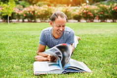 Man reading book in a park Royalty Free Stock Photo