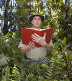 Man Reading Book in a Rainforest Royalty Free Stock Photos