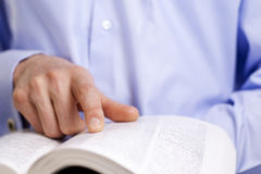 Hand and a book Royalty Free Stock Images