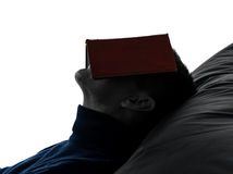 Man reading book silhouette portrait Royalty Free Stock Photography