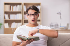 The man reading book sitting in couch sofa Royalty Free Stock Photo