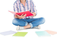 Man reading a book while sitting on the floor Stock Photos