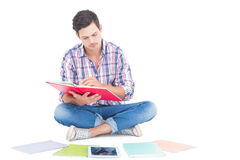 Man reading a book while sitting on the floor Royalty Free Stock Photos