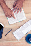 Man reading book on table Royalty Free Stock Image