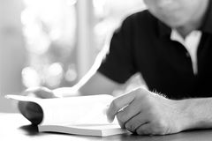 A man reading book on the table - monochrome effect Royalty Free Stock Photos