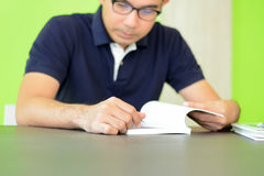 A man reading book on the table Stock Photo