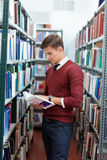 Man reading book in university library Royalty Free Stock Photography