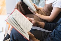 Man Reading Book Beside Woman Reading Book royalty free stock image