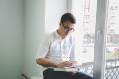 Man reading a book Stock Image