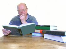 A man reading books. Working class scholar. An intelligent man looking for knowledge, reading, facts, science, electronics, books Royalty Free Stock Photos