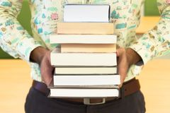 A man reading books. In the library Stock Images