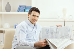 Man Reading Business News Stock Photography