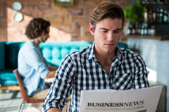 Man reading a business newspaper. In coffee shop Royalty Free Stock Photography