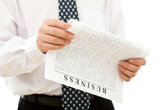 Man reading business paper Stock Photography