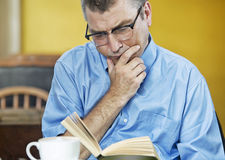Man  reading concentrated Stock Image