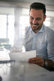 .Man reading contractor. Business man checking document Stock Photography