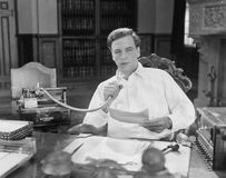 Man reading into Dictaphone. (All persons depicted are no longer living and no estate exists. Supplier grants that there will be no model release issues Stock Images