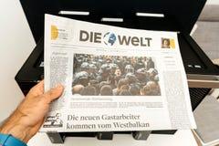 Man reading Die Welt German newspaper Stock Image