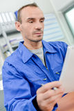 Man reading document at desk Stock Photography