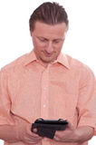 Man is reading in an ebook reader Stock Photos