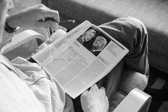 Man reading The Economist magazine with Donald Trump and Hillary Royalty Free Stock Image