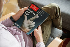 Man reading The Economist about upcoming elections Stock Photo