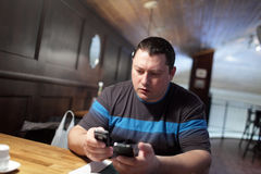 Man reading email in a pub Royalty Free Stock Photo