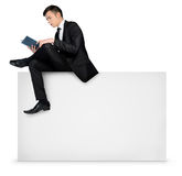 Man reading on empty board Royalty Free Stock Images