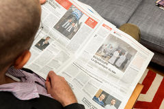 Man reading about evolutions of French business in newspaper Royalty Free Stock Photos