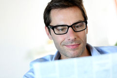Man reading with eyeglasses Stock Photography