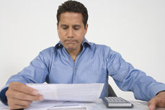 Man Reading Financial Document Stock Photo