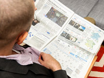 Man reading about French cinema and cinema industry in France Stock Photography