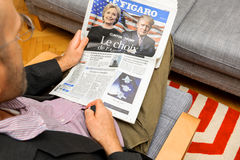 Man reading french magazine about Hillary Clinton and Donald Tru Royalty Free Stock Image