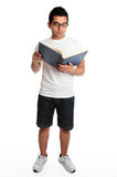 Man reading a hardcover book Royalty Free Stock Photo