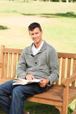 Man reading his book on the bench Royalty Free Stock Image
