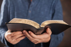 Man reading the holy bible. Man reading from the holy bible, close up Royalty Free Stock Photo