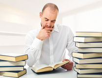 Man reading at home. Man reading a book and 3d indoor background Royalty Free Stock Image