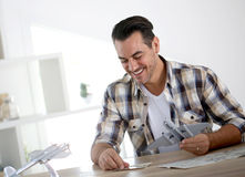 Man reading instructions assembling plane toy Stock Image
